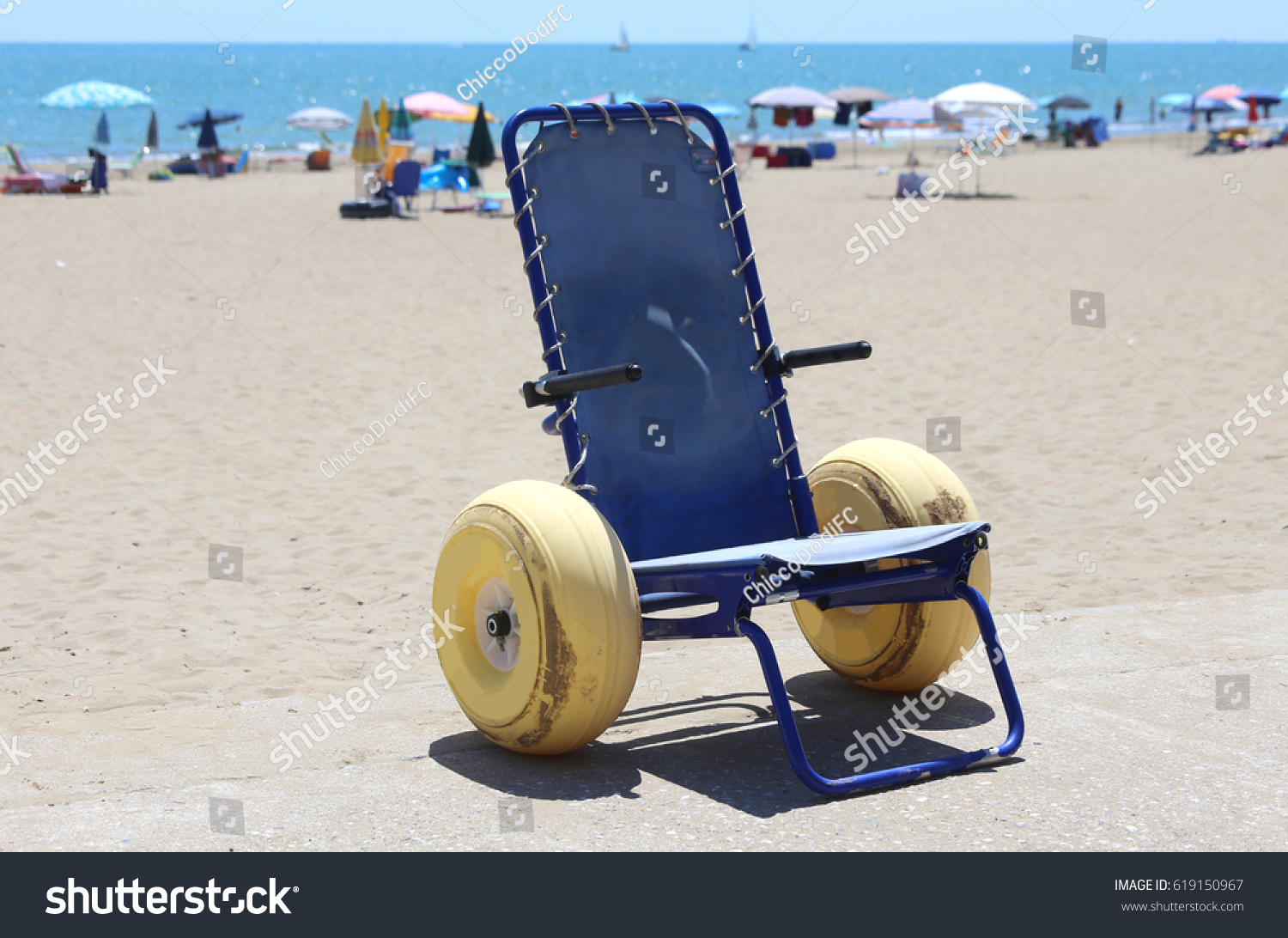 Special wheelchair with large inflatable wheels to go in the sea and on the  beach