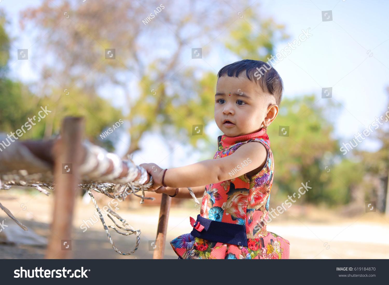 royalty-free cute indian baby girl #619184870 stock photo | avopix