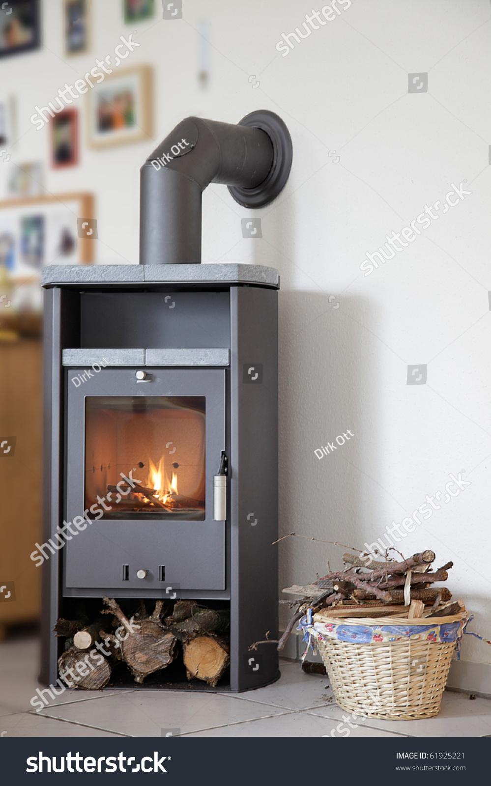 Modern wood burning stove inside cozy living room stock - Living room with wood burning stove ...