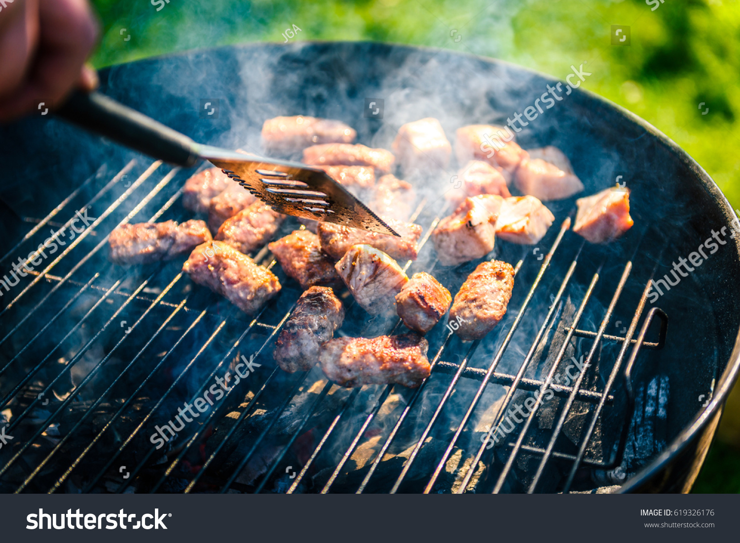 grilling delicious variety meat on barbecue stock photo 619326176