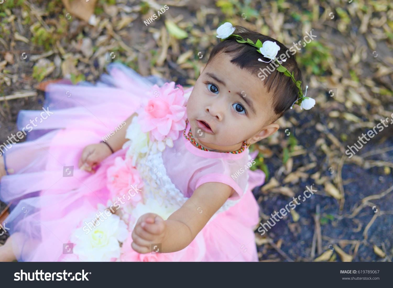 royalty-free cute indian baby girl #619789067 stock photo | avopix