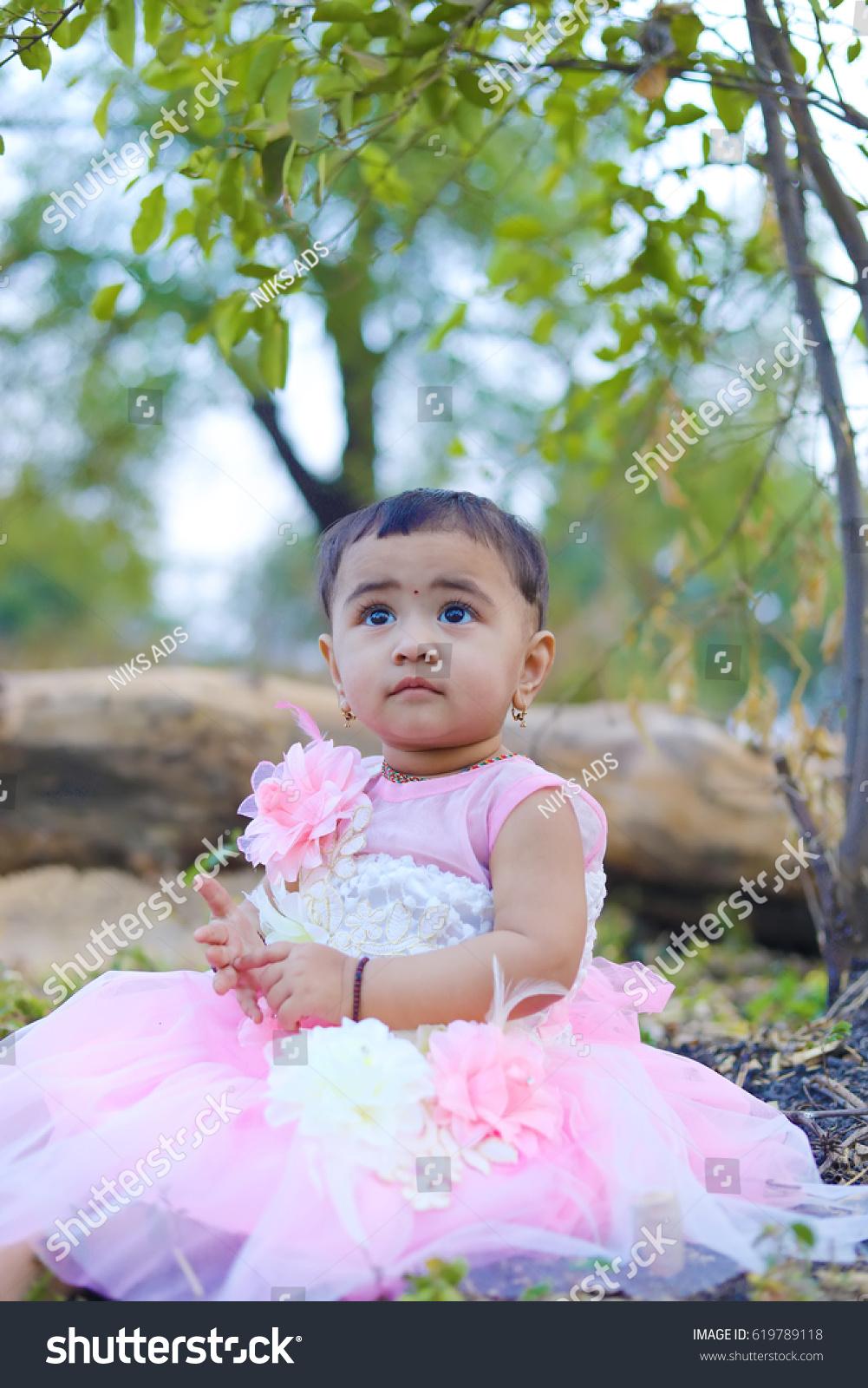 royalty-free cute indian baby girl #619789118 stock photo | avopix