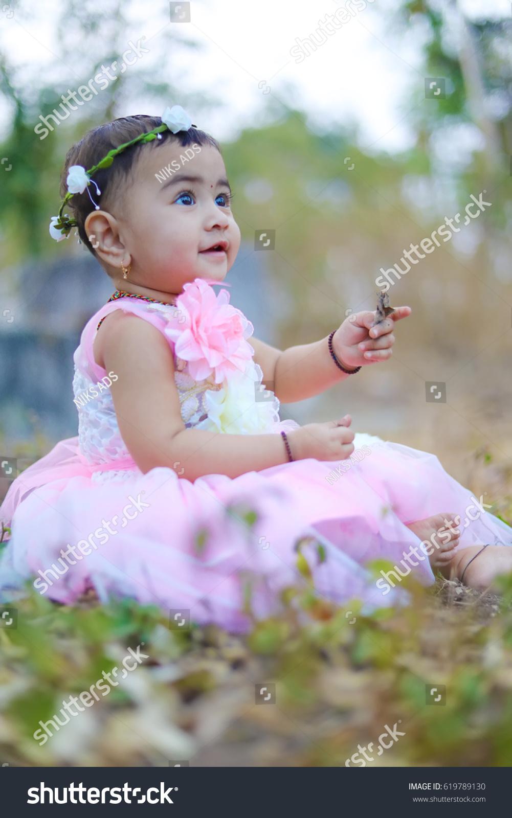 royalty-free cute indian baby girl #619789130 stock photo | avopix
