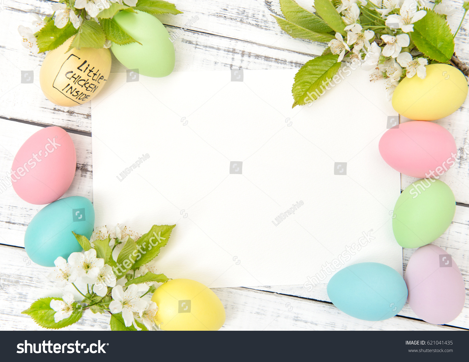 Easter greetings card eggs decoration spring stock photo 621041435 easter greetings card eggs decoration and spring flowers pastel colored eggs on wooden background kristyandbryce Images