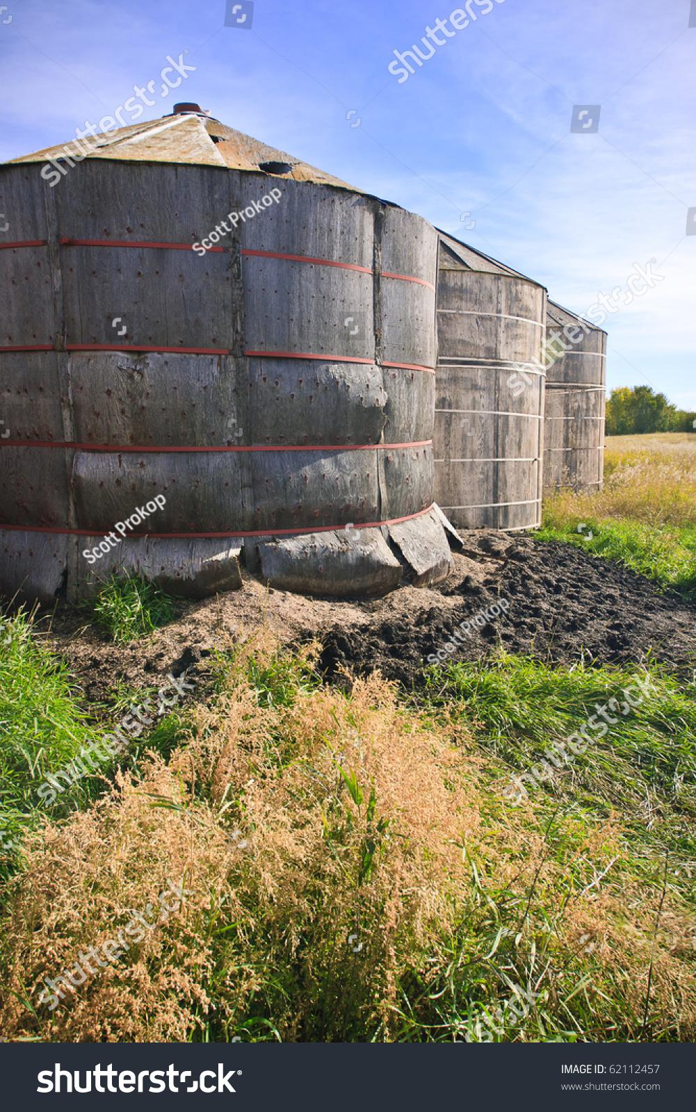 Wood Grain Storage : Old wood grain storage bins on the prairies stock photo
