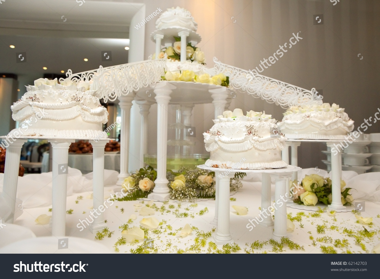 Wedding Cakes With Roses Connected By Bridges The