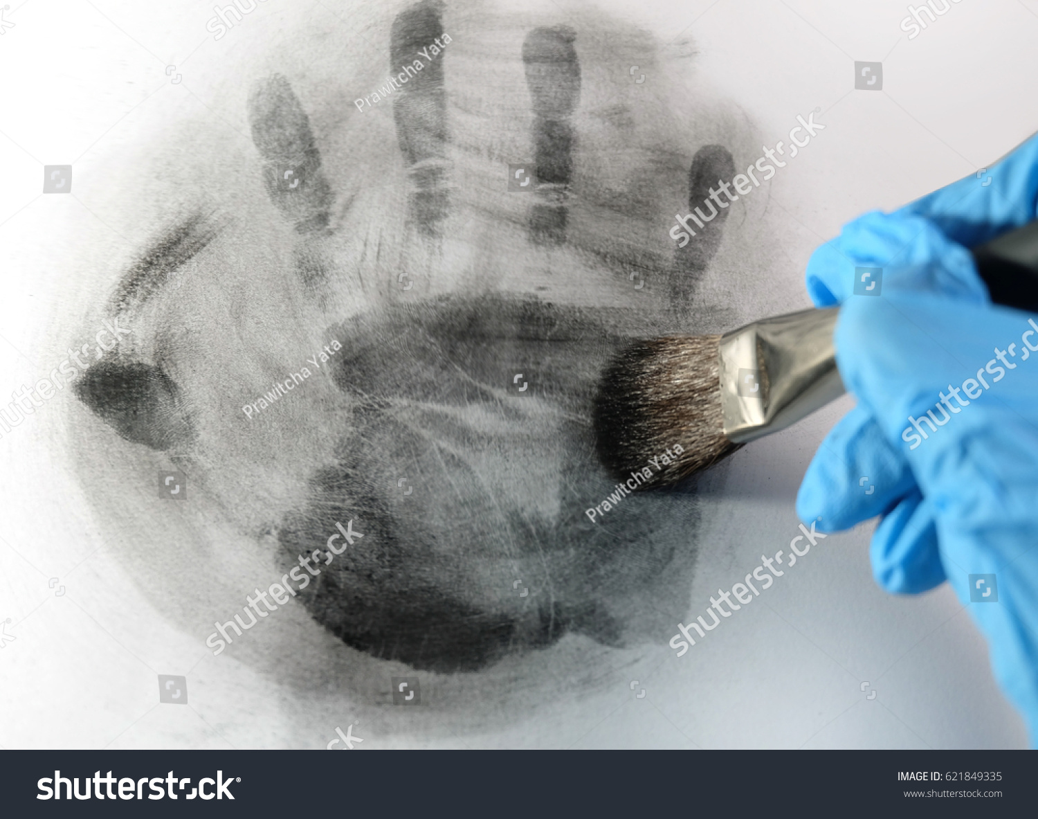 Latent Fingerprint Searching By Forensic Hand Stock Photo Edit Now 621849335