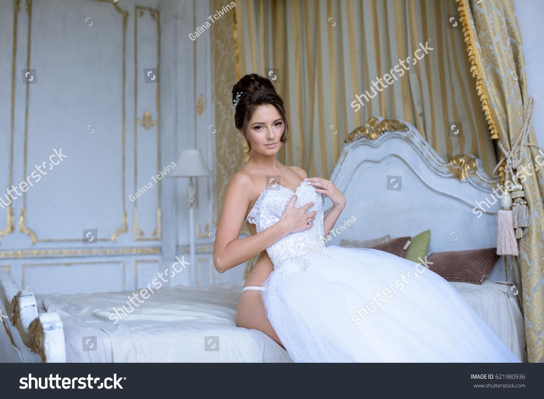 db858eb7529 Beautiful bride in lingerie is wearing a wedding dress. Beauty model girl  in white underwear