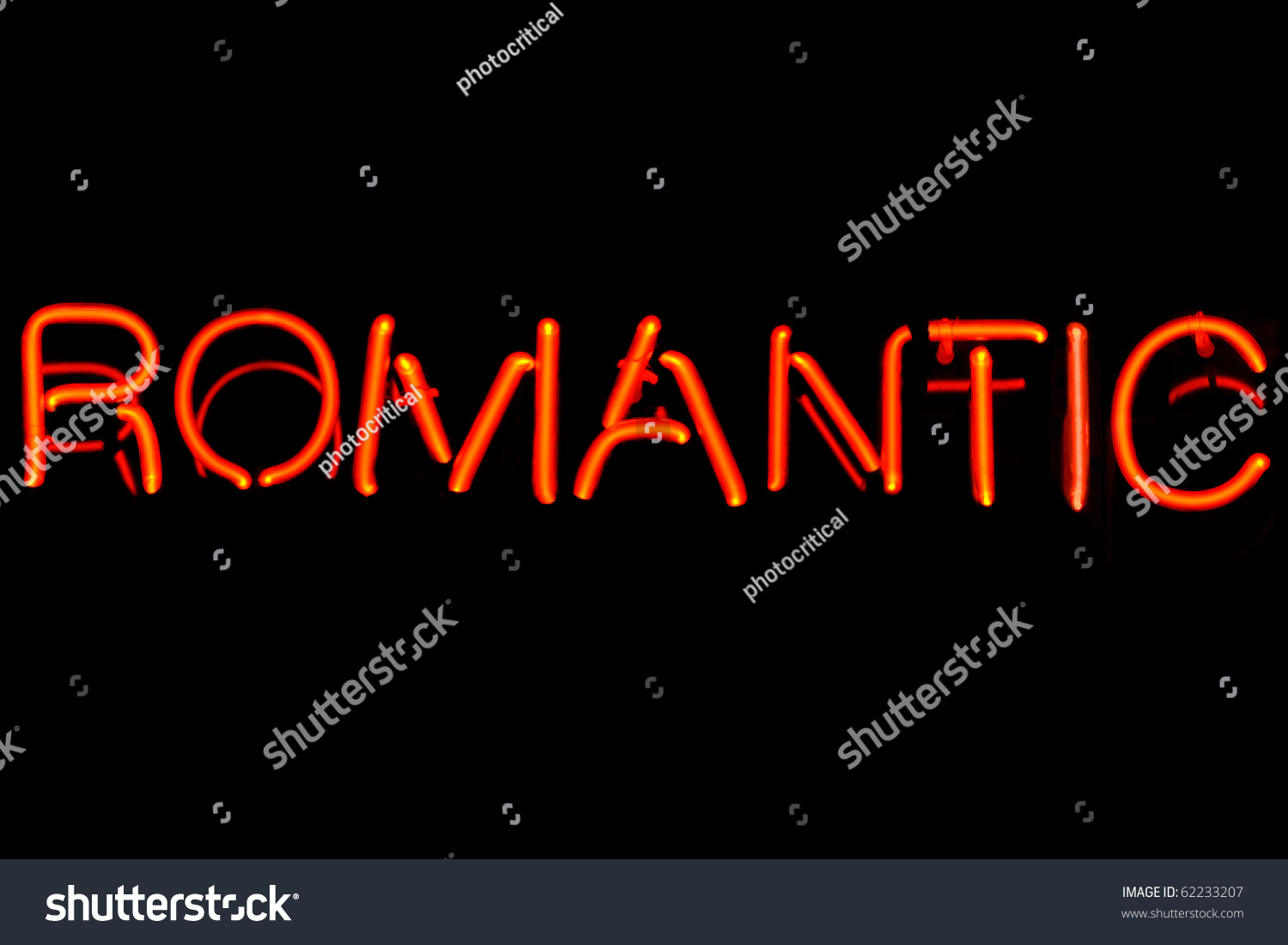 Red Neon Sign Of The Word 'Romantic' On A Black Background ...