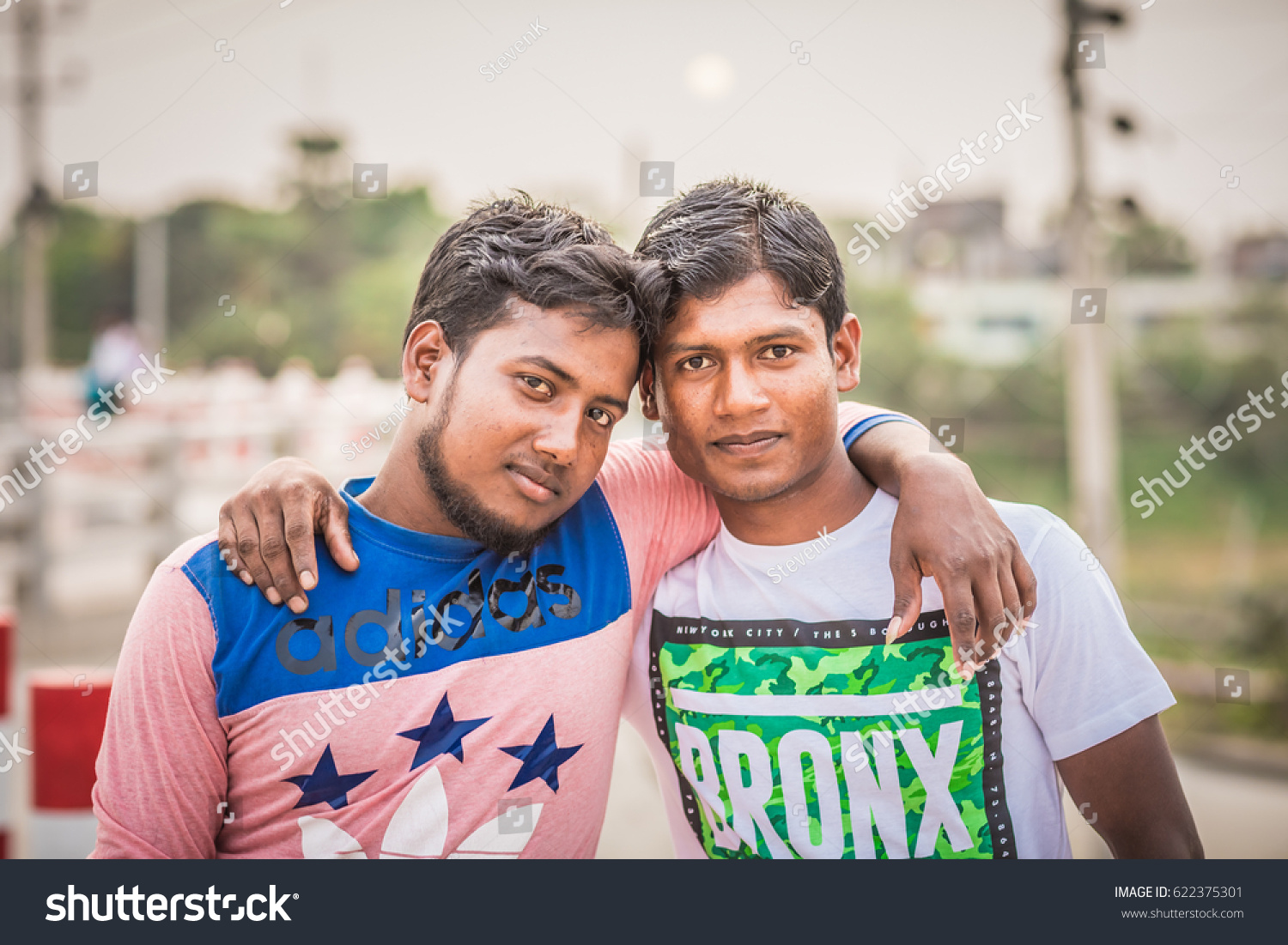 Dhaka bangladesh april 15 2017 two bangladeshi friends posing in front of