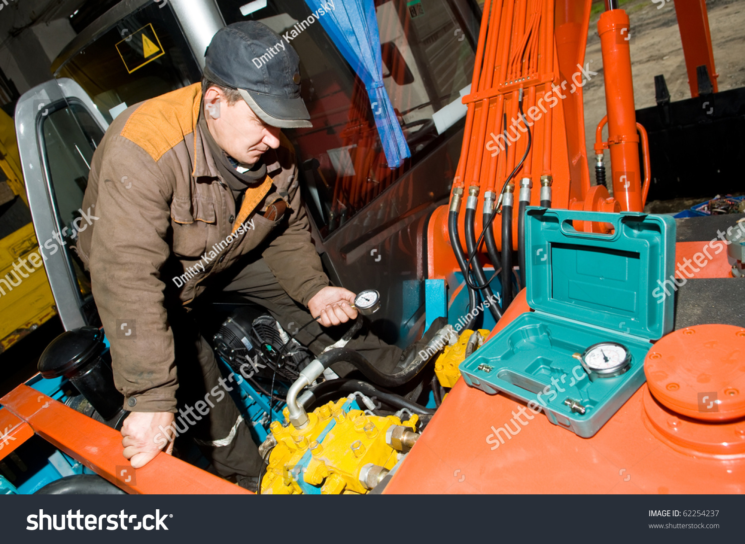 Serviceman Repairman Checking Hydraulic Pressure By Stock Photo ...
