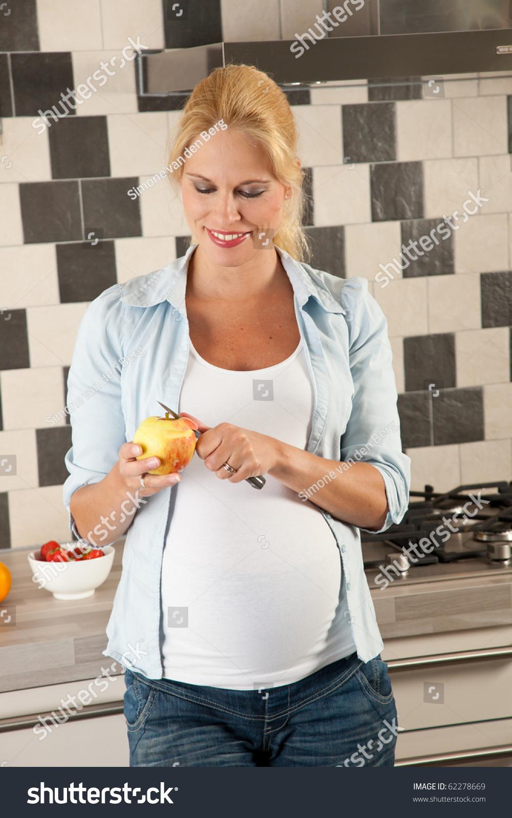 Beautiful Pregnant Woman Standing Kitchen Peeling Stock Photo ...