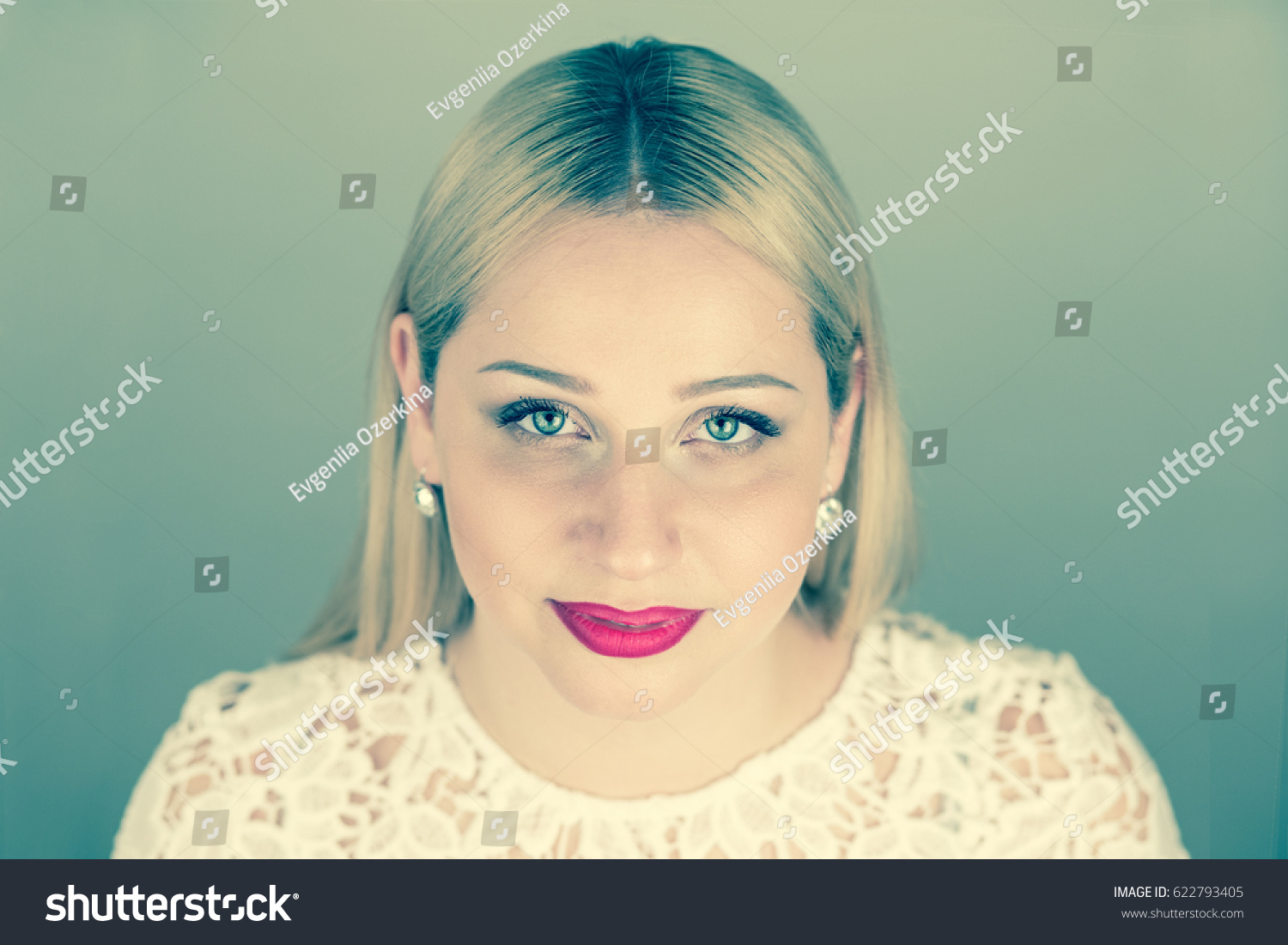 full face young  blonde woman with red lips. Toning blue  Cross Process