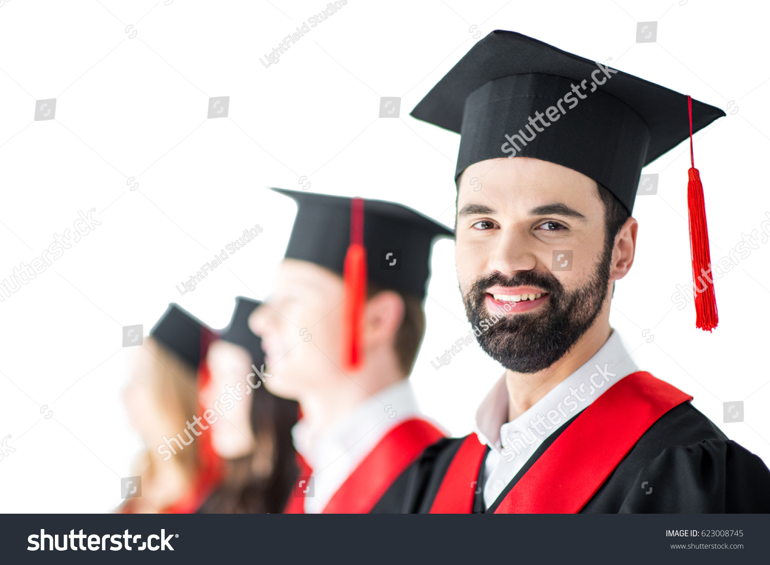 bearded student graduation cap diploma friends stock photo  bearded student in graduation cap diploma friends behind isolated on white
