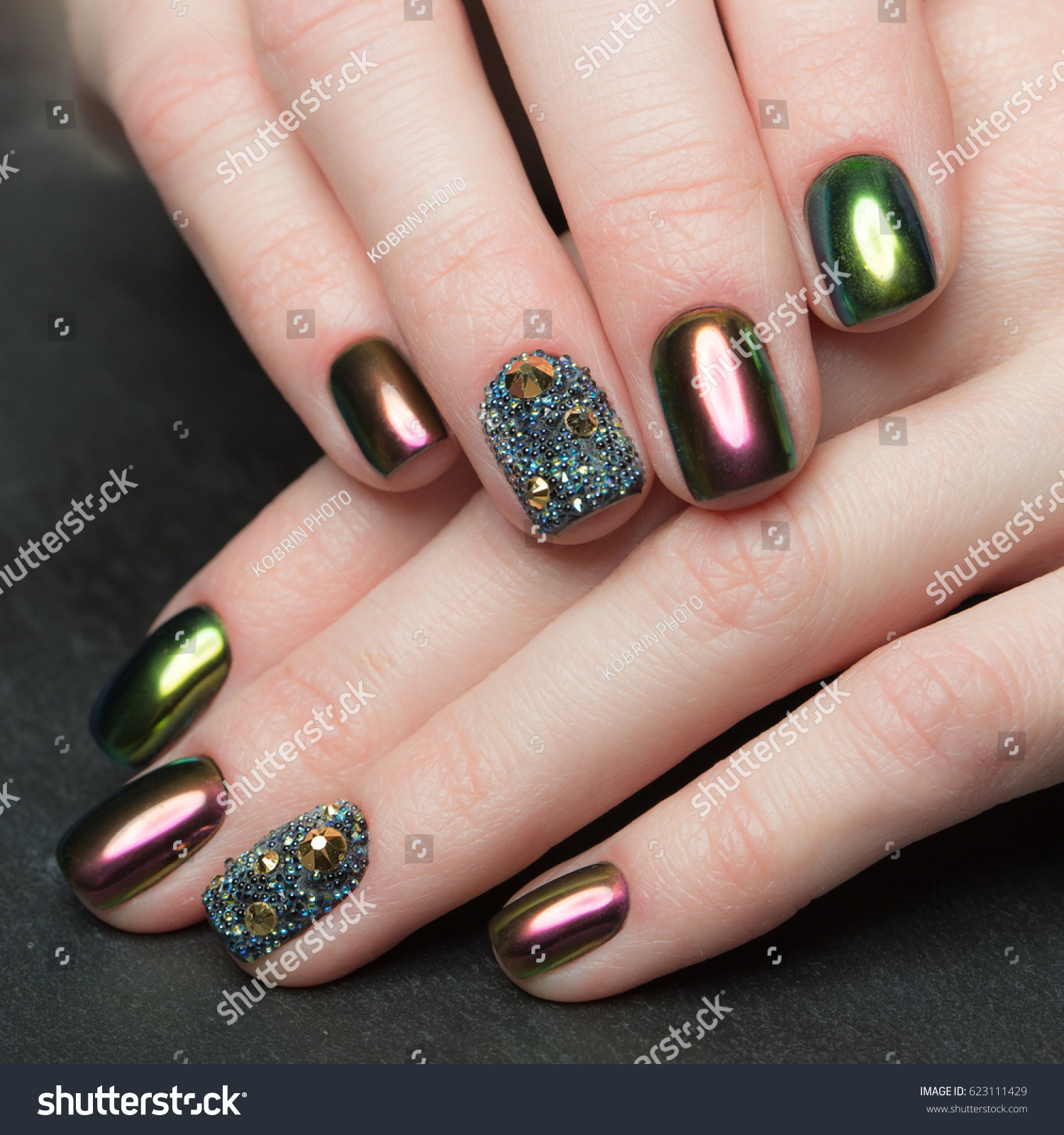 Beautifil colorful manicure rhinestone nail design stock photo beautifil colorful manicure with rhinestone nail design close up prinsesfo Image collections