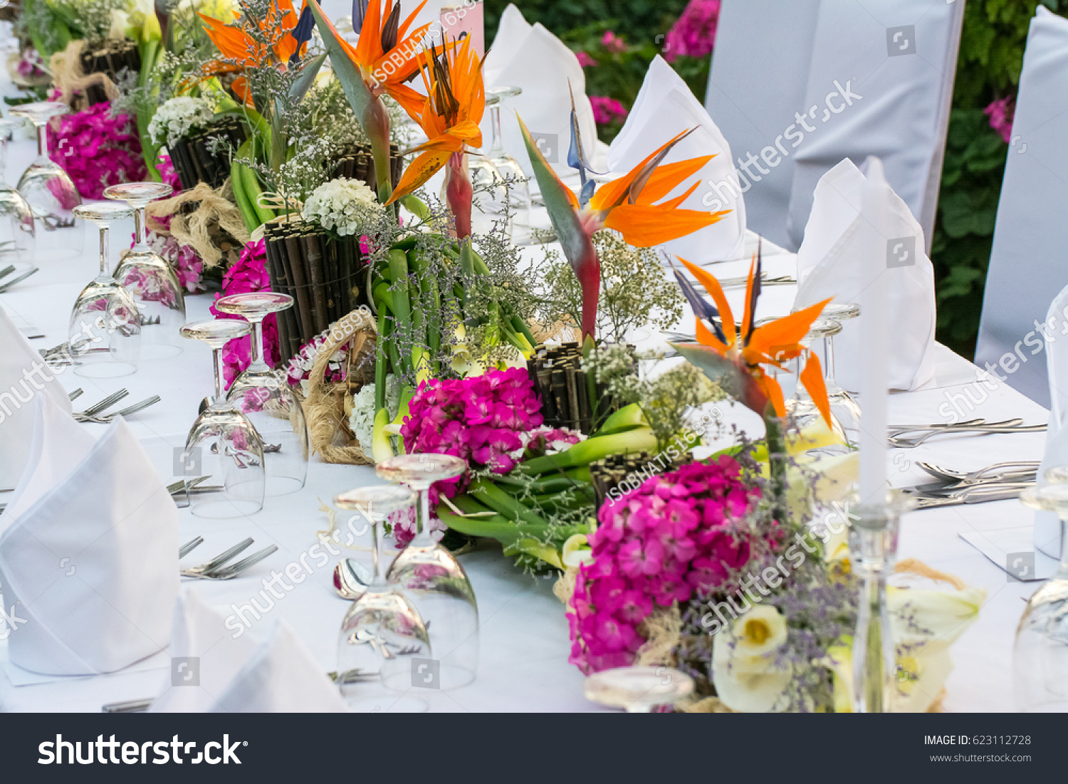 Beautiful flower arrangement on long dinner stock photo safe to use beautiful flower arrangement on long dinner table at some public outdoor garden izmirmasajfo