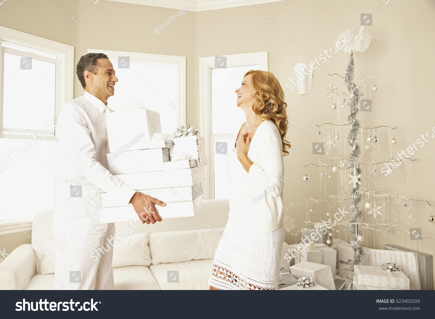 Hispanic Man Giving Wife Christmas Gifts Stock Photo (Edit Now ...