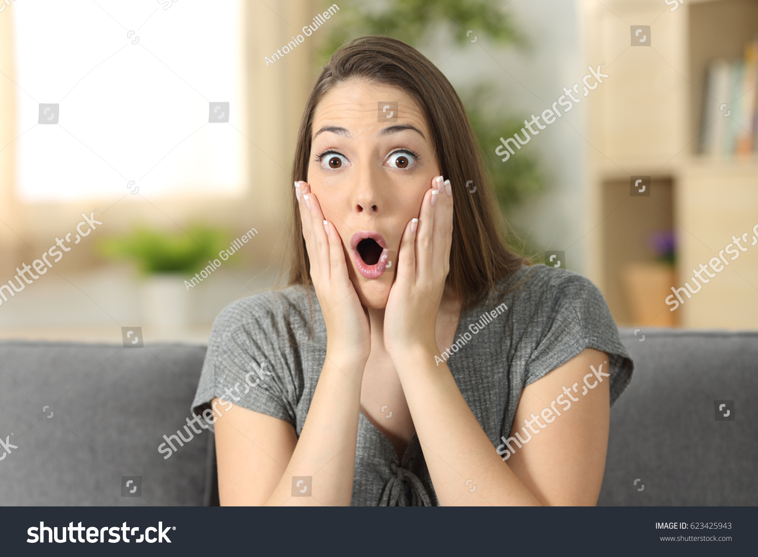 stock-photo-woman-amazed-looking-at-you-
