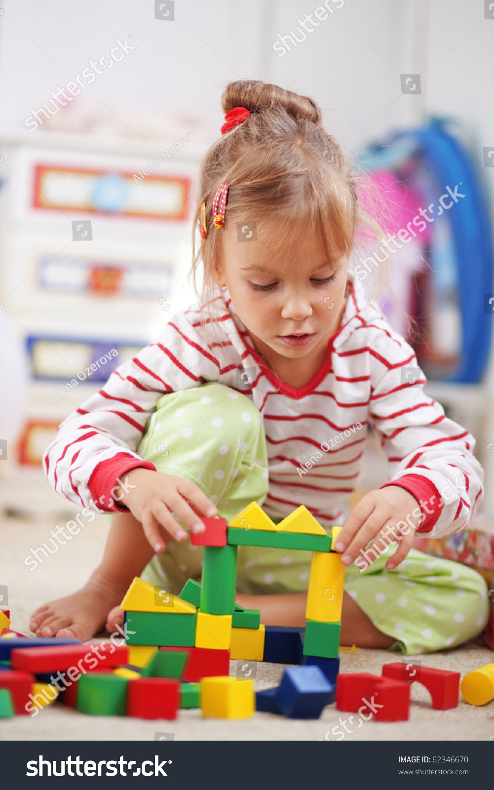 Child Playing With Blocks In The Kindergarten Stock Photo ...