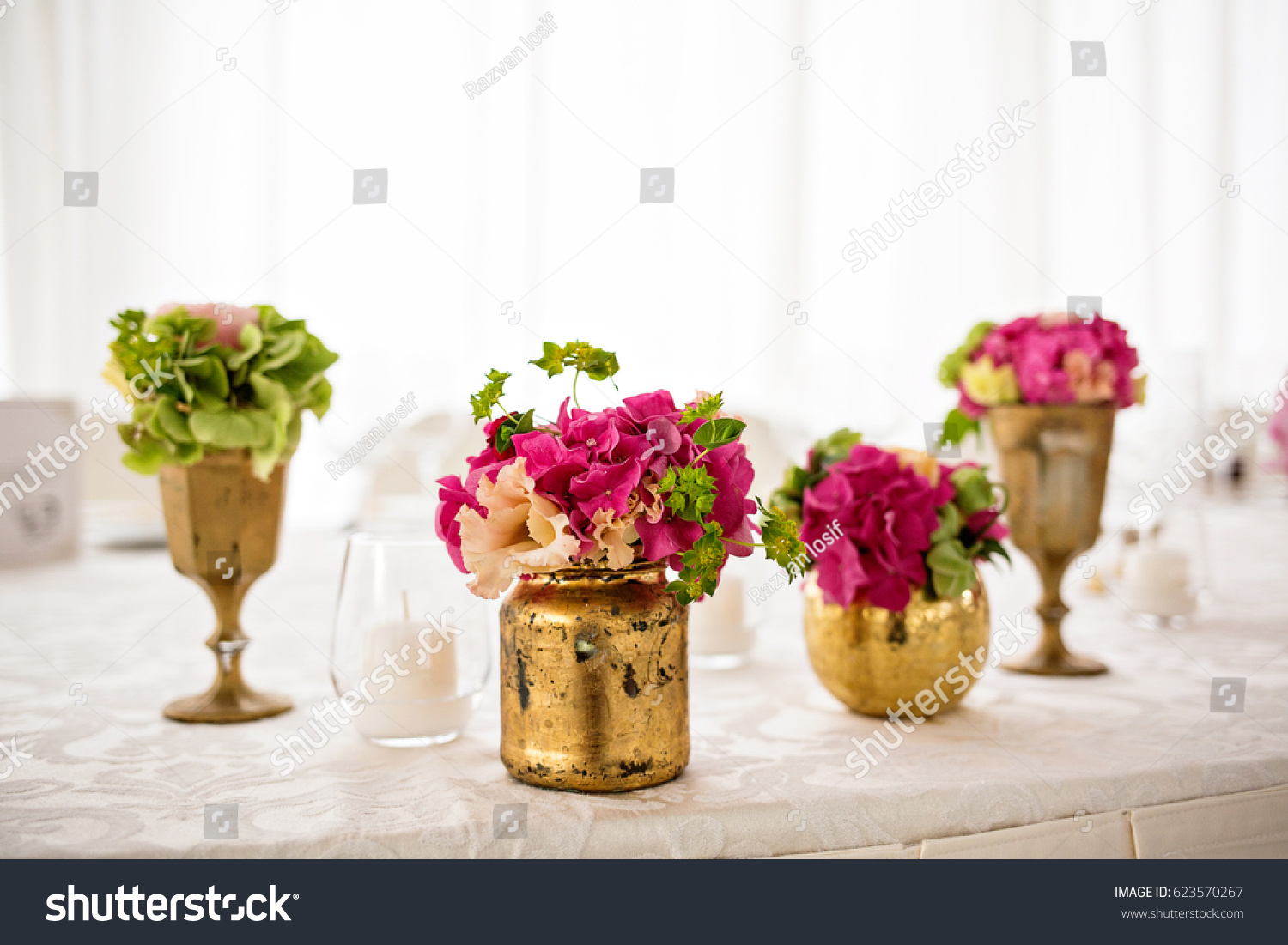 Beautiful flower bouquets elegant bronze gold stock photo beautiful flower bouquets in elegant bronze and gold vases flower arrangements in different style vases reviewsmspy