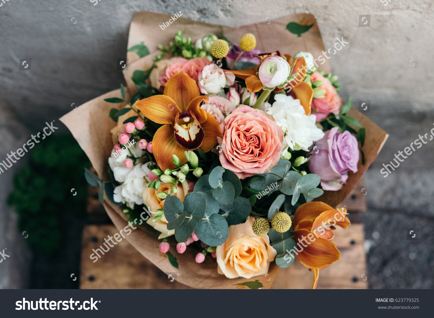 Colorful bouquet different fresh flowers against stock photo edit colorful bouquet of different fresh flowers against brick wall bunch of orchids roses izmirmasajfo