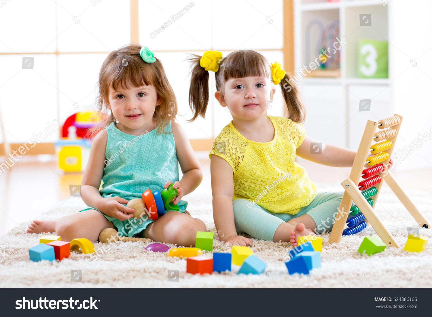 children playing together toddler kid baby stock photo