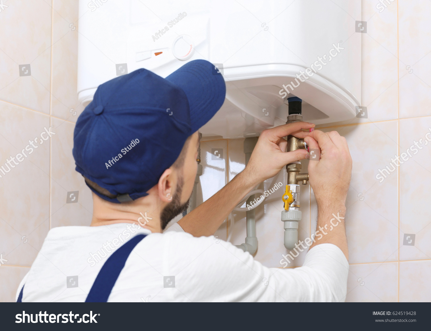 Plumber Installing Water Heater Bathroom Stock Photo Edit Now How To Wire In