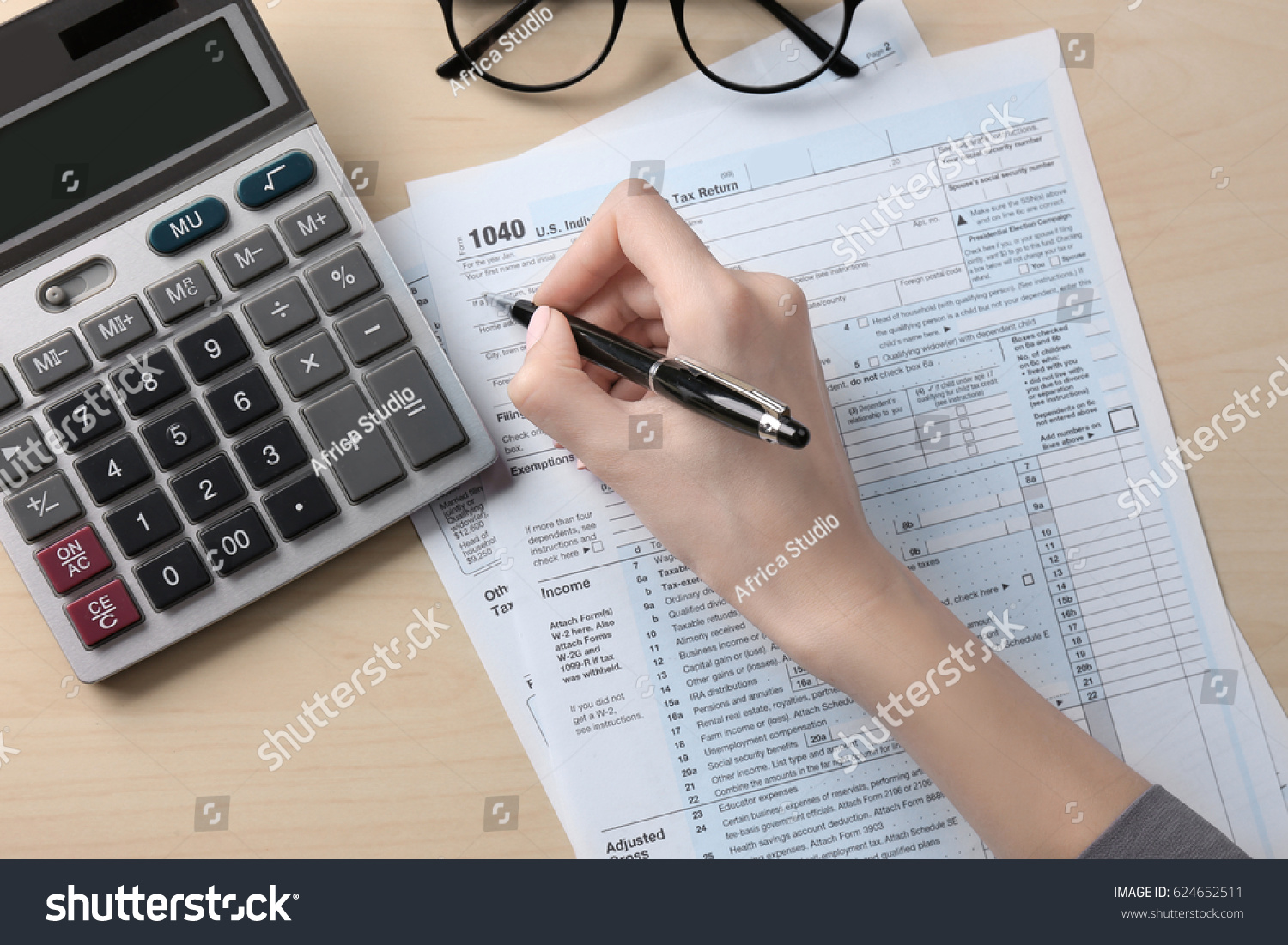 woman filling in individual income tax form, closeup | ez canvas