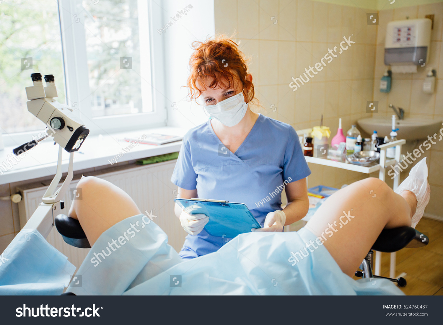 Red Hair Female Positively Gynecologist Examining Stock -5810