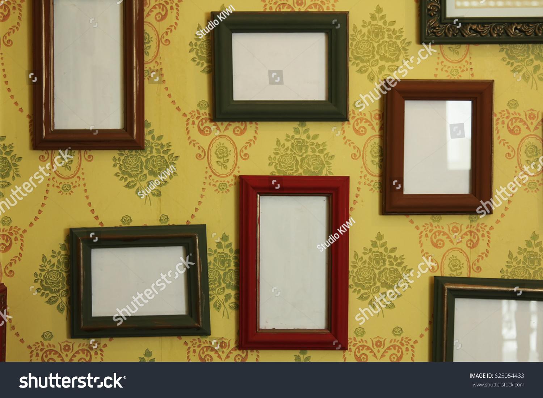 Empty Photo Frames Hang On Wall Stock Photo (Royalty Free) 625054433 ...