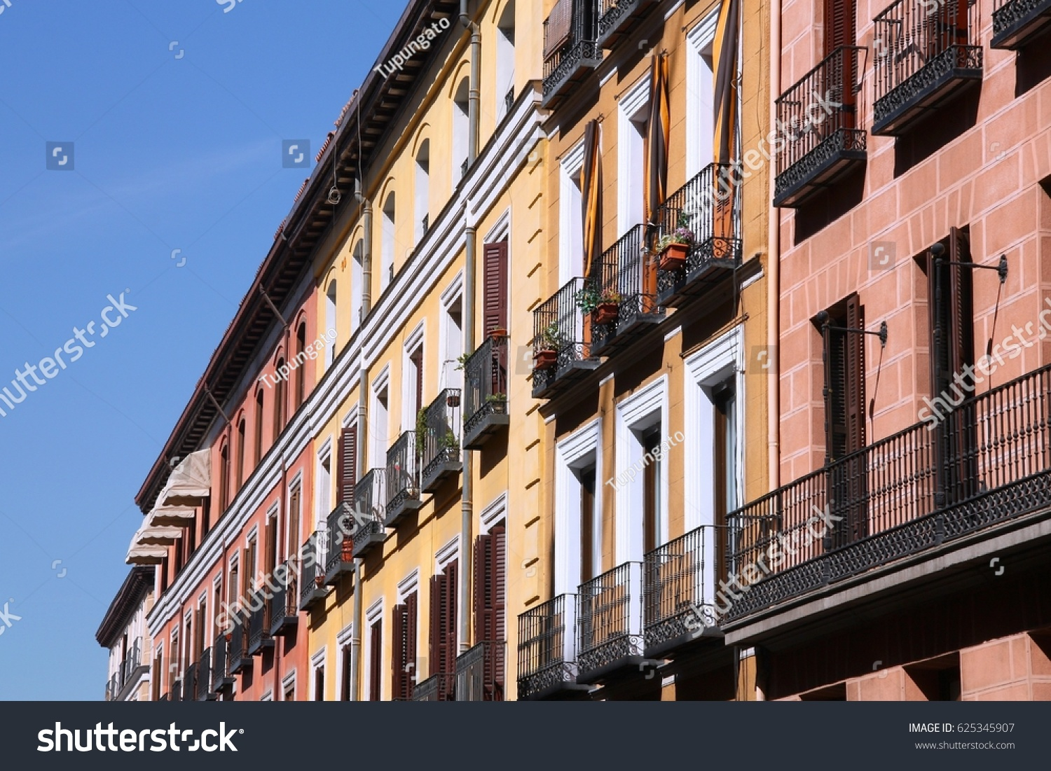 Mediterranean Architecture In Spain. Old Apartment Buildings In Madrid    Calle Mayor.