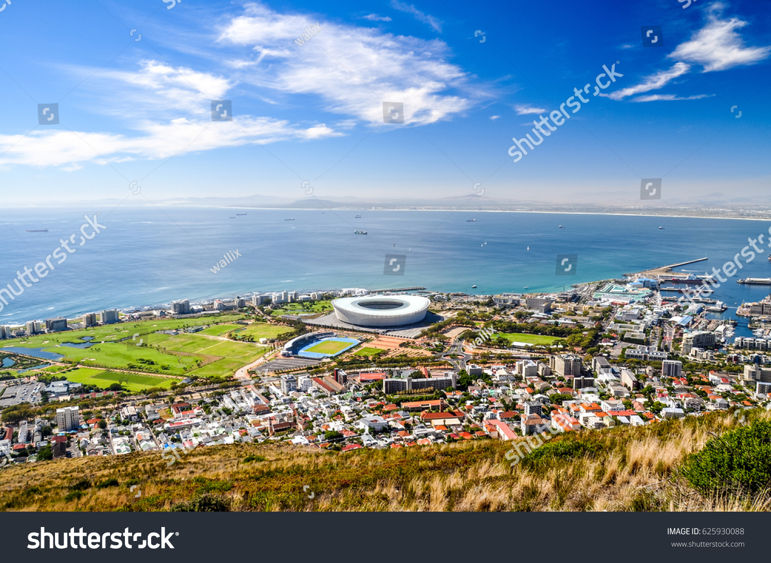 Beautiful view of Mouille Point, Green Point with a football stadium and the V and A (Victoria and Alfred) Waterfront in Cape Town seen from Signal Hill. Sunny day with a few clouds. South Africa.  #625930088