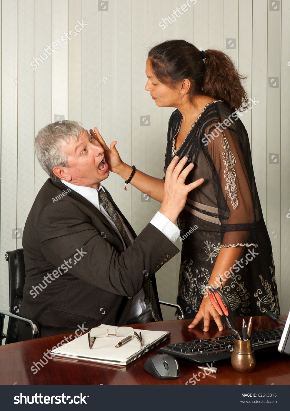 secretary defending herself her scissors against stock photo