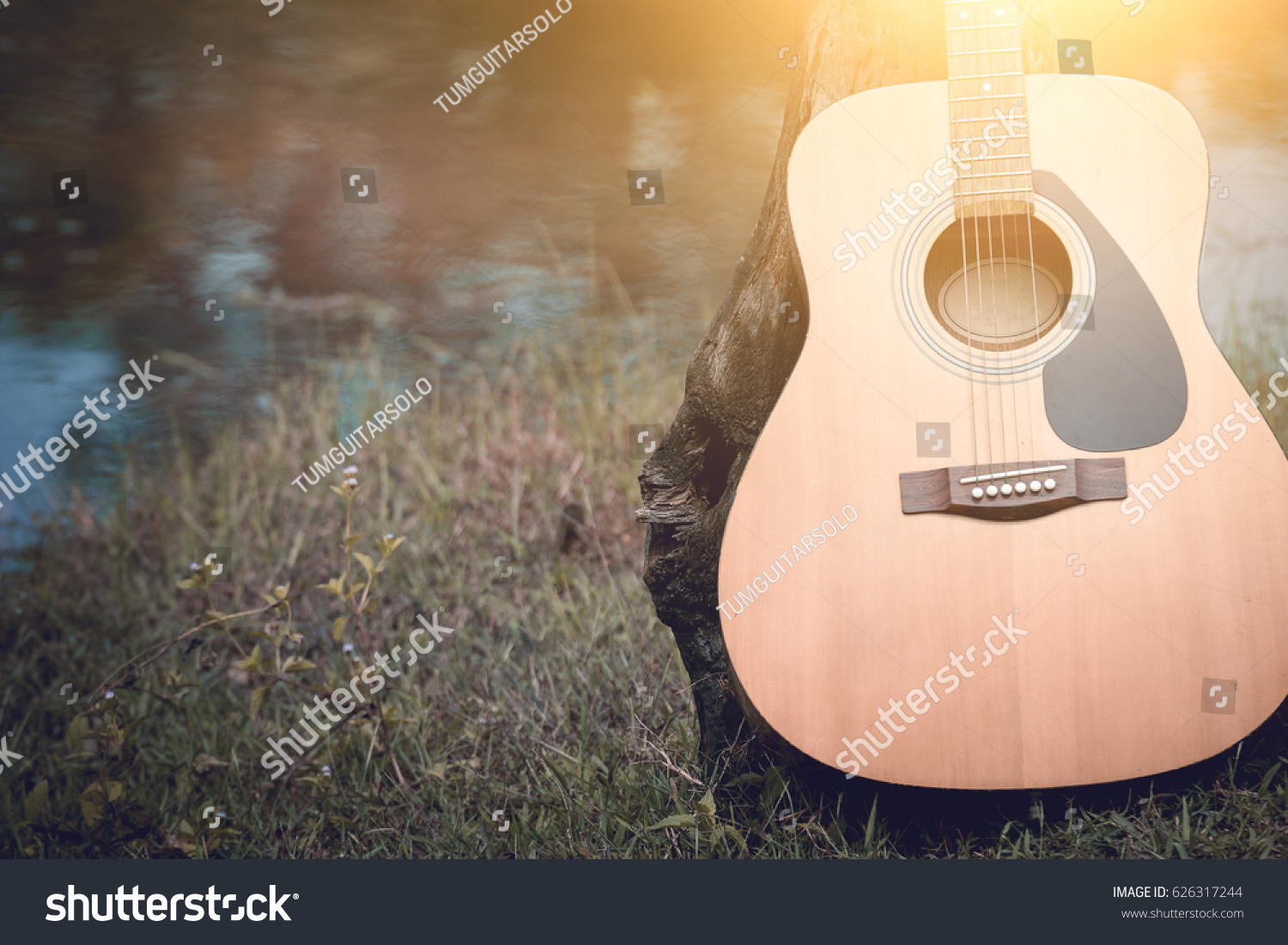 Acoustic Guitar Background On Riverside Stock Photo Edit Now