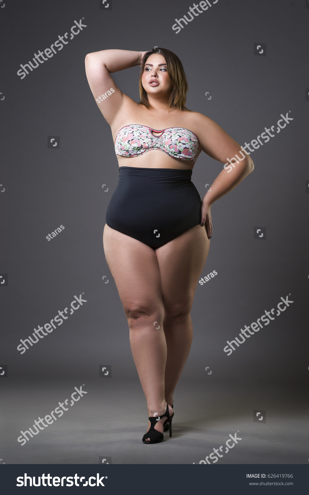 b5160dac75 Stock photo plus size fashion model in sexy swimsuit young fat woman on gray  studio background