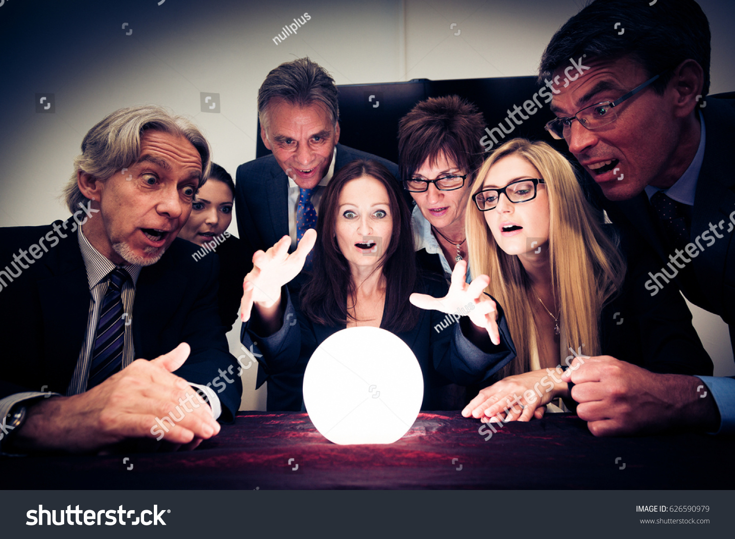 Business Team Using A Crystal Ball To Look Into Future #626590979