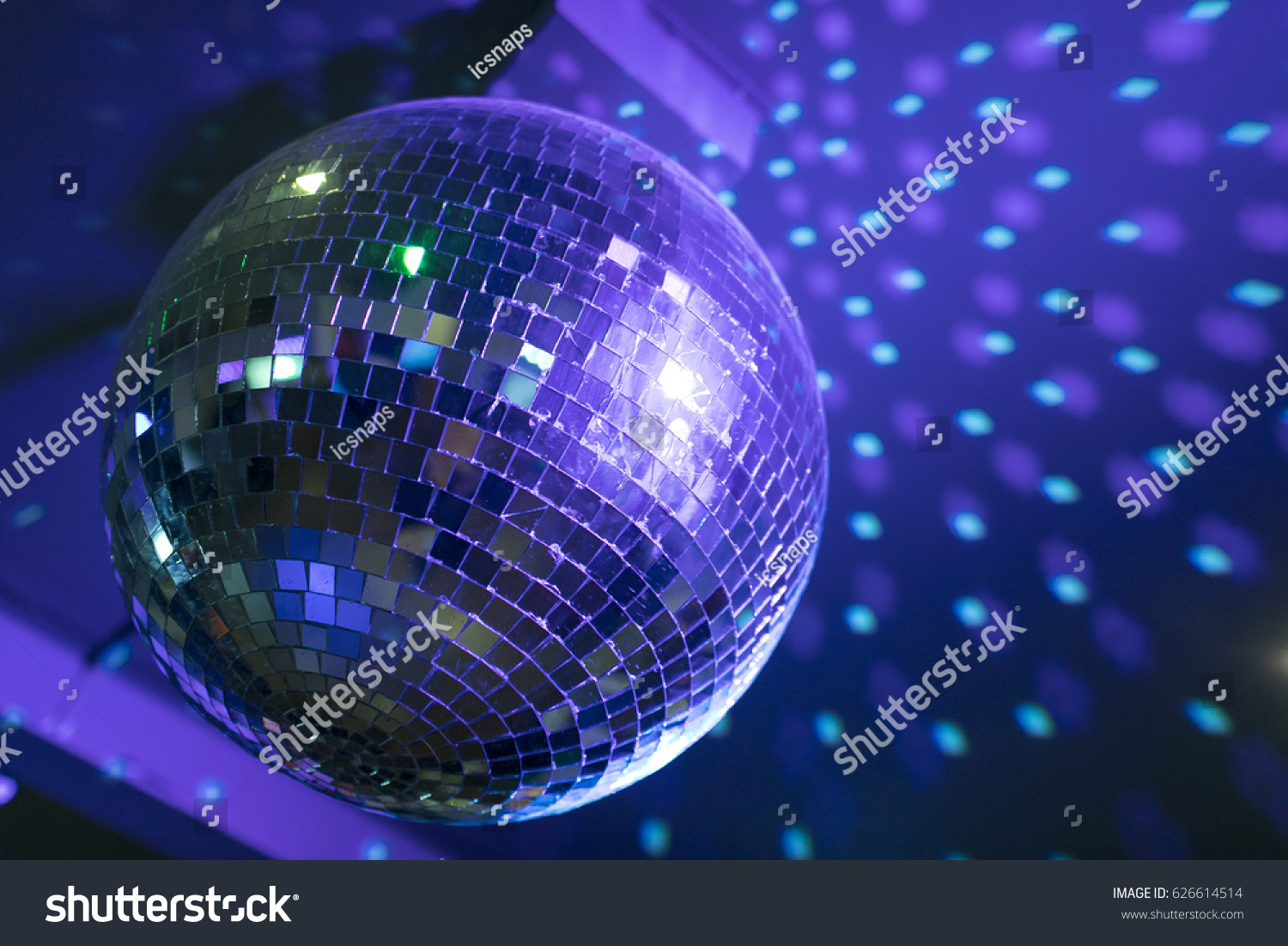Disco ball reflecting purple green lights stock photo 626614514 disco ball reflecting purple and green lights from the ceiling aloadofball Images