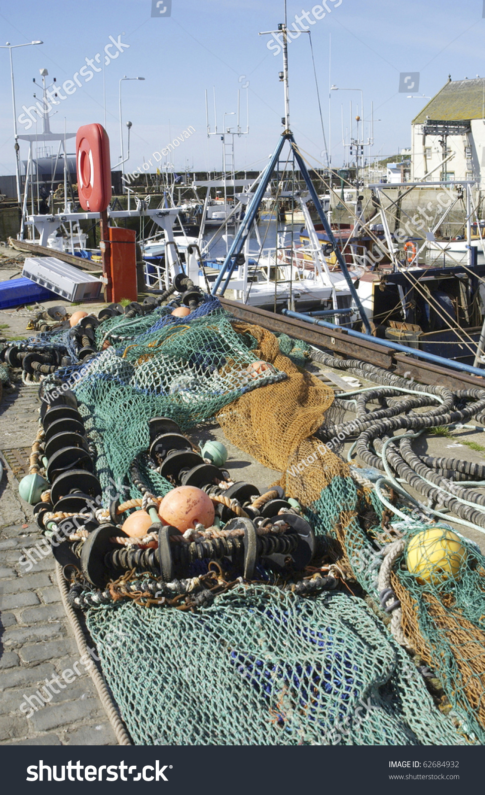 fishing nets and deep sea fishing equipment lying on pier with, Reel Combo