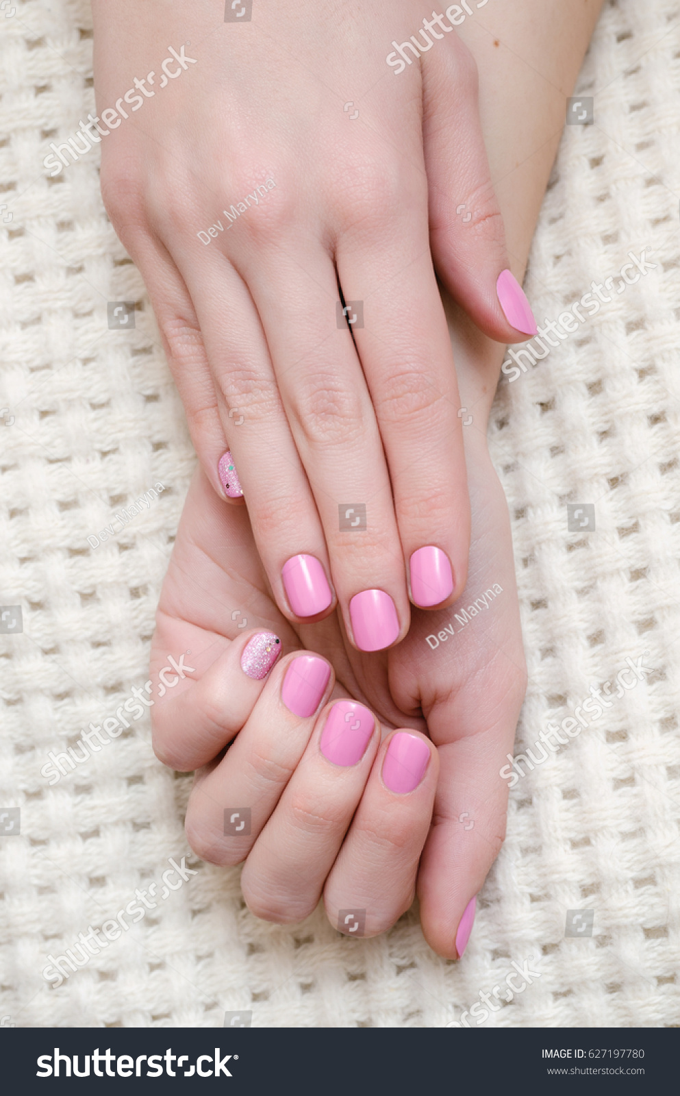 Nail art beautiful female hand warm stock photo 627197780 nail art beautiful female hand with warm pink manicure prinsesfo Gallery