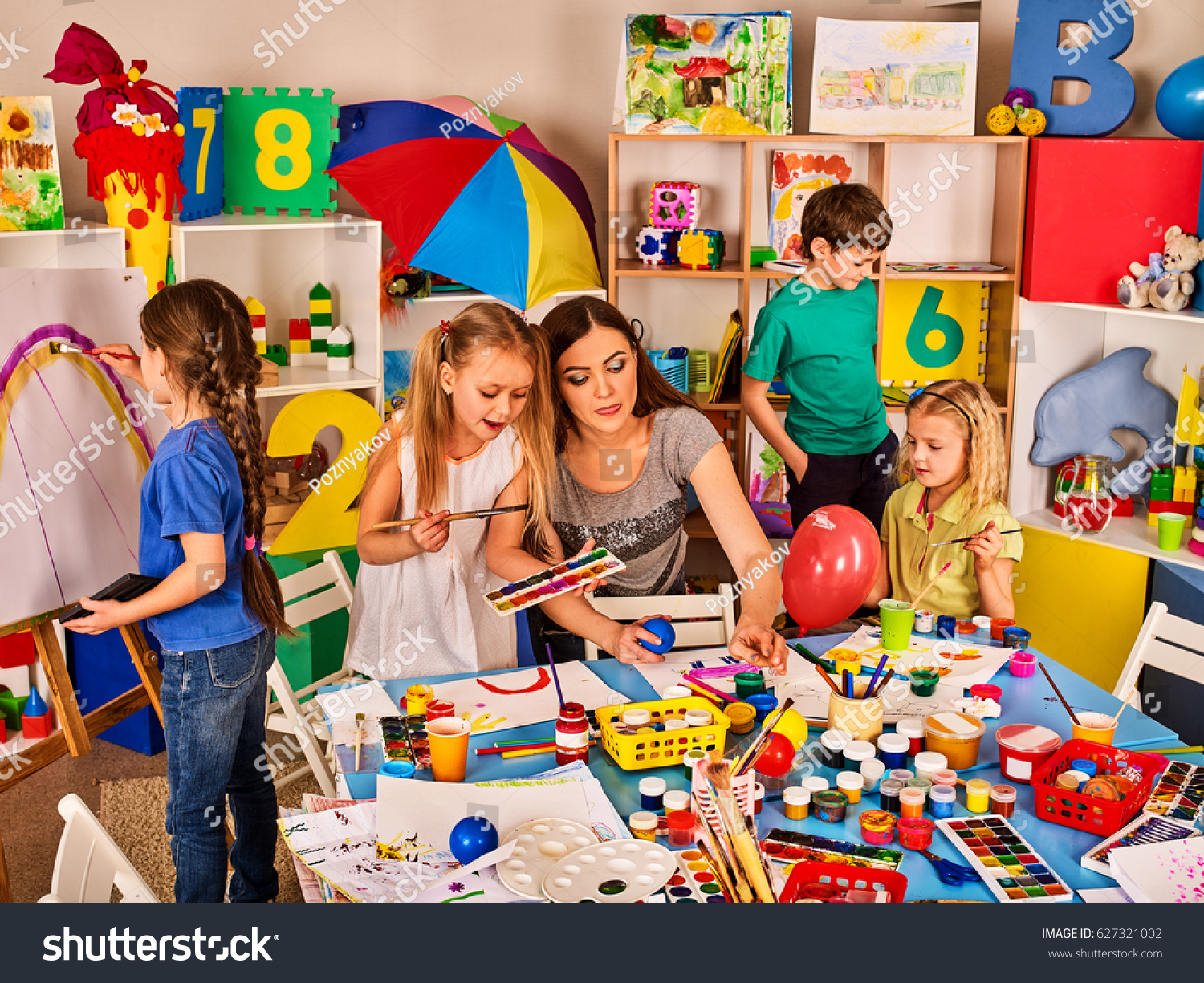 small students teacher painting art stock photo 627321002