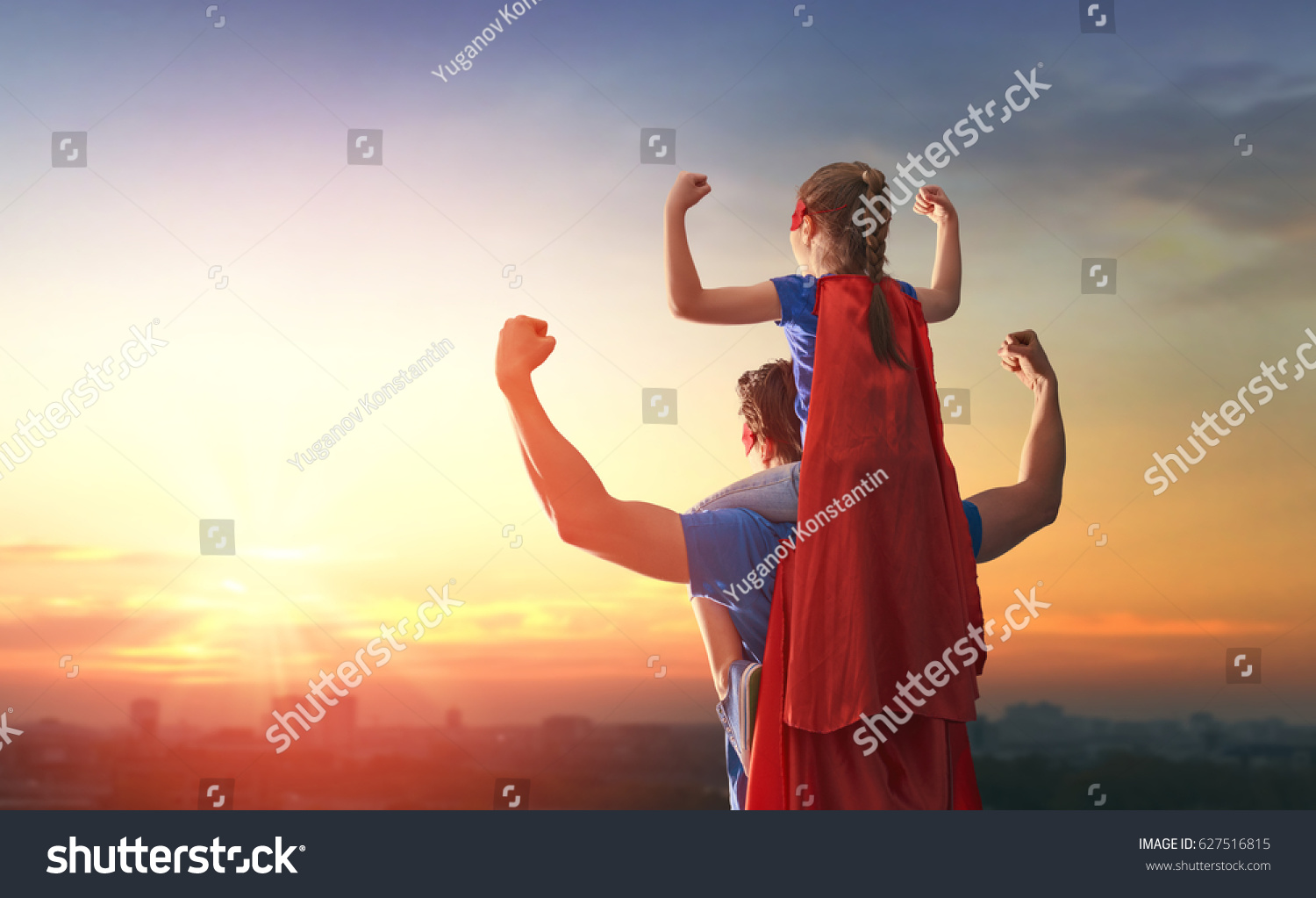 Happy loving family. Dad and his daughter playing outdoors. Daddy and child girl in an Superhero's costumes. Concept of Father's day. #627516815