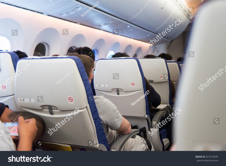 man sleep chair airplane during travel stock photo royalty free