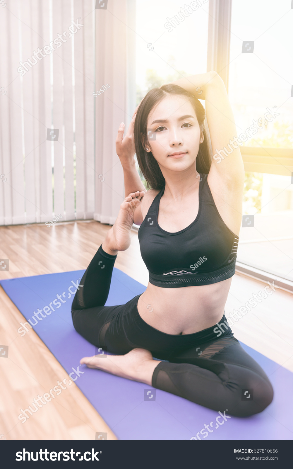 Beautiful young fit asian woman doing yoga. Asian girl with long black  hair, black