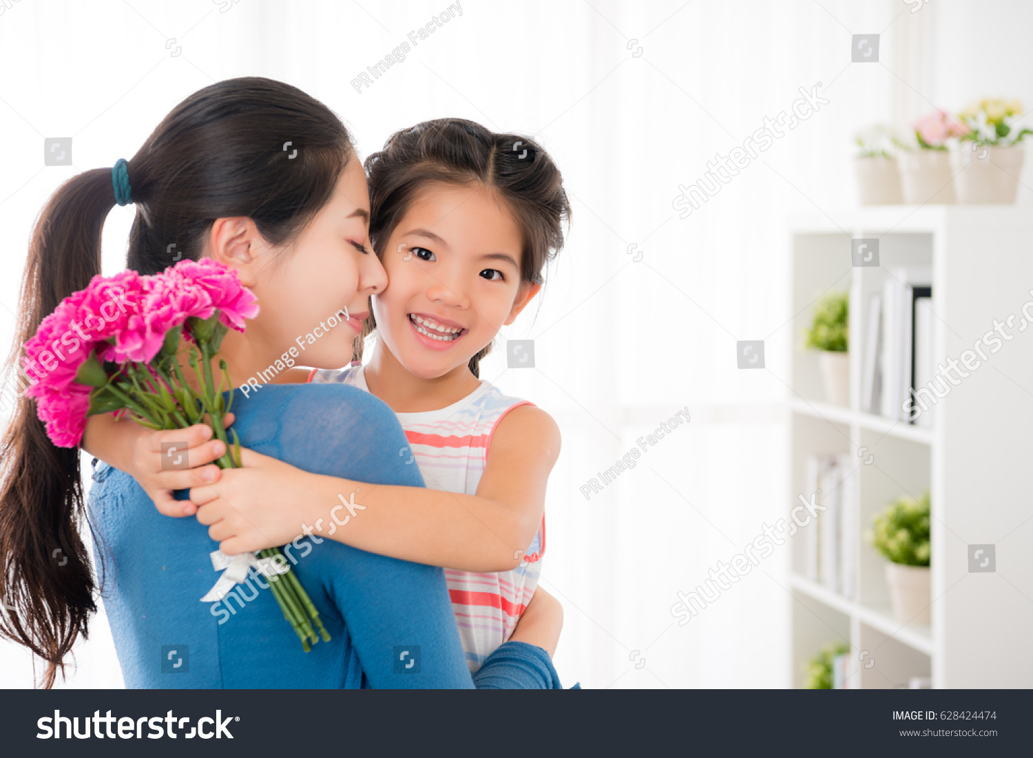 asian young mother embrace smiling little stock photo (edit now