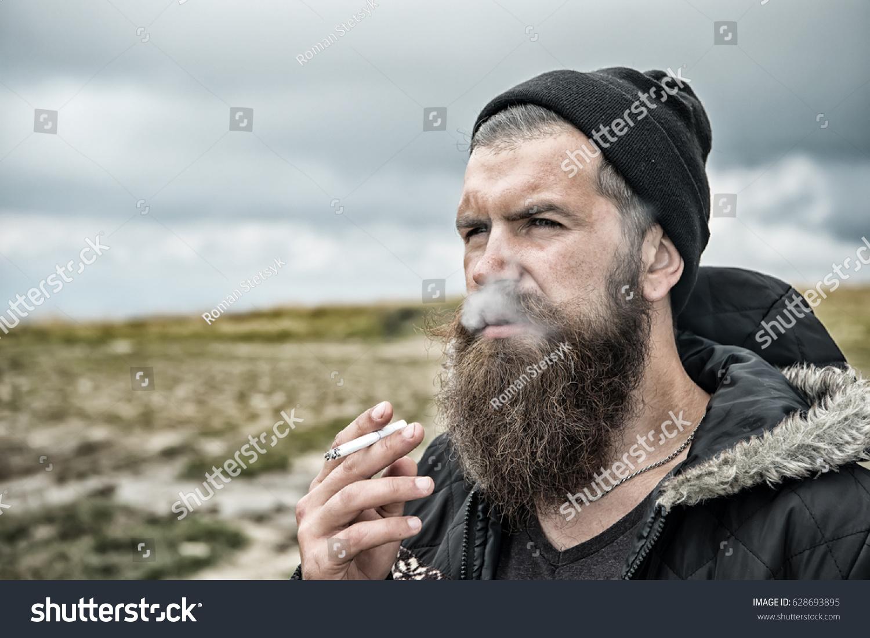 2fc7a48f9ae Royalty-free Man smoking cigarette