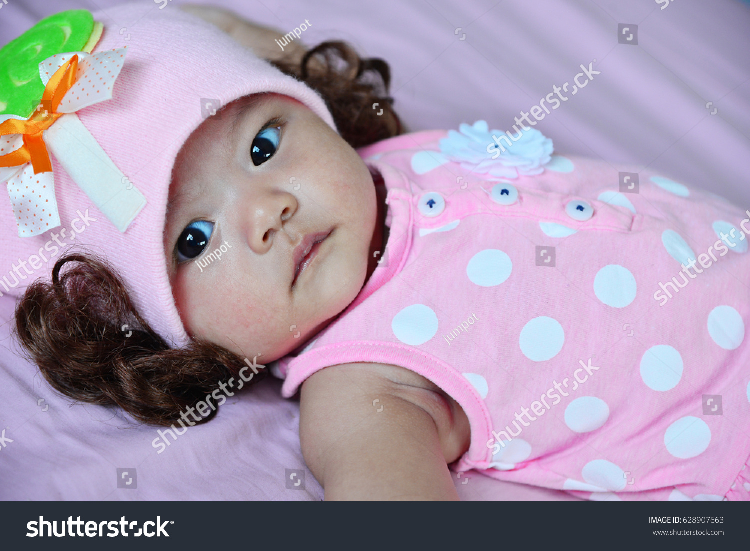 little cute baby girl pink dress stock photo (100% legal protection