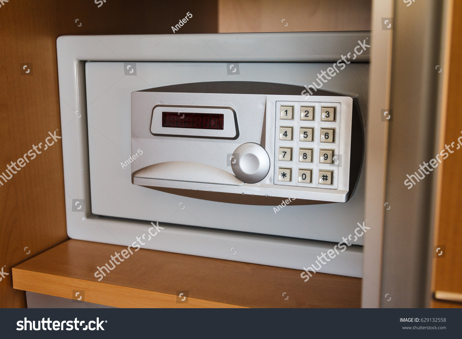 Close up of electronic hotel safe for valuables and money hidden in a  secret place of