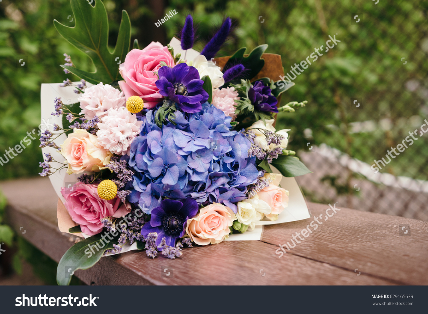 Blue And Pink Bouquet Of Flowers Wrapped In Paper Bunch Of Fresh