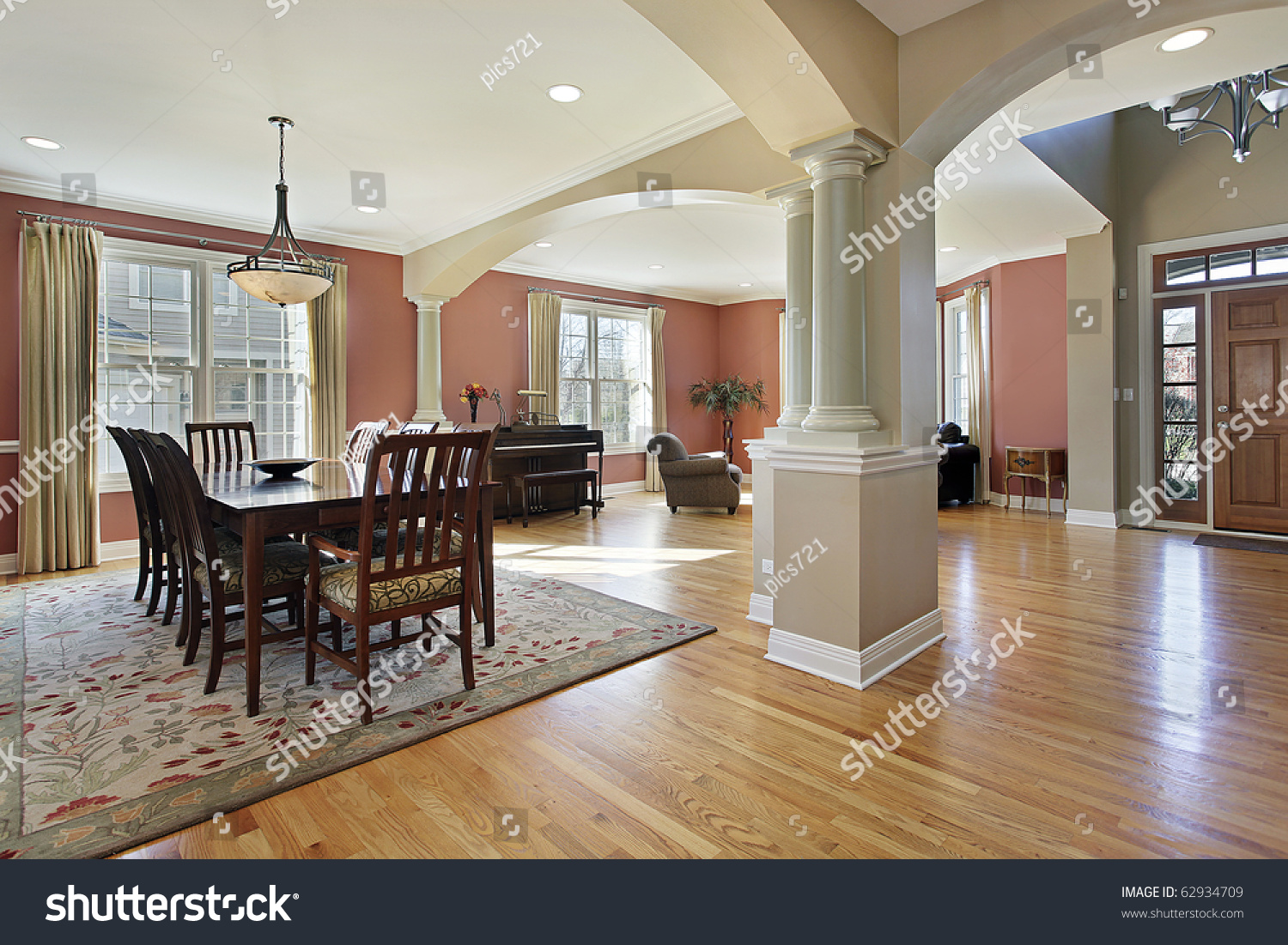 Dining room in open floor plan with foyer view stock photo for Open floor plans with a view