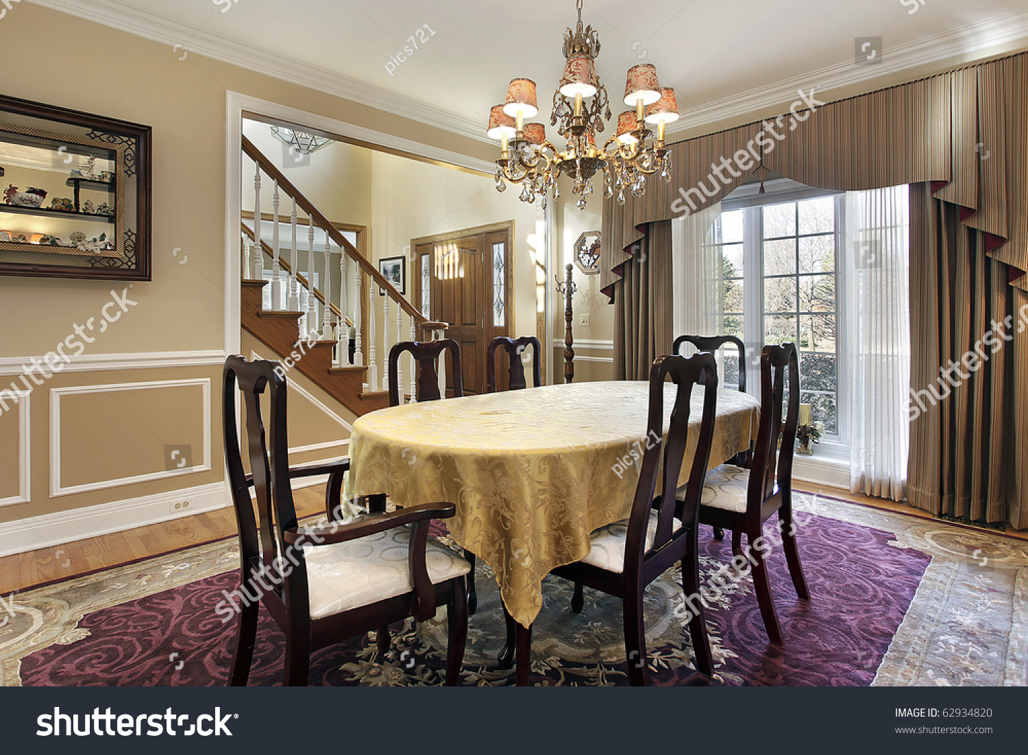 Dining Room With Tan Walls And Foyer View Stock Photo 62934820 ...